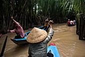 Numerous boats sail through the Mekong Delta in the vicinity of Ho Chi Minh City (Vietnam)\nHO CHI MINH-VIETNAM