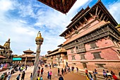 Kathmandu, Nepal - September 21 2019: People walking around Patan Durbar Square, a UNESCO Heritage site in Nepal. Temples reconstruction after Earthquake.