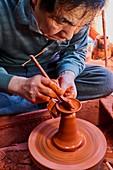 Japan, Honshu, Aichi prefecture, Tokoname, Mr Shoji Umehara potter making a Kyusu teapot