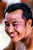 A Portrait Of A Male Performer At A Traditional Balinese Barong and Kris Dance Show, Batabulan, Bali, Indonesia.