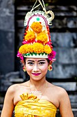 A Young Balinese Hindu Female In Festival Costume At The Batara Turun Kabeh Ceremony, Besakih Temple, Bali, Indonesia.