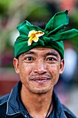A Portrait Of A Balinese Hindu Man At The Batara Turun Kabeh Ceremony, Besakih Temple, Bali, Indonesia.