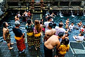 Balinese Visitors Bathing In The 'Holy Spring' Pools During A Hindu Festival, Tirta Empul Water Temple, Bali, Indonesia.