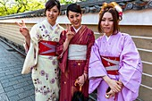 Kyoto Japan. Women dressed with traditional kimono garment in the streets of Kyoto