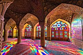 Nasir-ol-Molk Mosque or Pink Mosque, Light patterns from colored stained glass illuminating the iwan, Shiraz, Fars Province, Iran, Asia