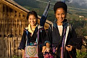Some Hmong women in Sapa way to the nearby villages of Lao Chai and Ta Van. Vietnam. Trekking Sapa to Lao Chai. Vietnam.