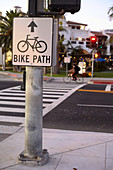 Pedestrian and bicycle crossing in the evening light on East Cabrillo Boulevard in Santa Barbara, California, USA.