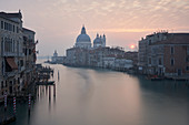 Sunrise from the Accademia Bridge looking towards Santa Maria della Salute, Venice, Italy.