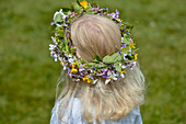 A girl carries flowers in her hair, Midsummer Festival, Långaryd, Halland, Sweden
