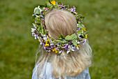 A girl carries flowers in her hair, Midsummer Festival, Långaryd, Halland, Sweden