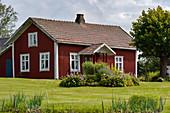 Red Swedish house with a beautiful garden, Smålandsstenar, Jönköpings Län, Sweden