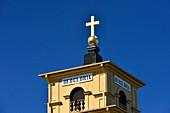 Church spire with shining golden cross against a blue sky, Gammelstad, Luleå, Norrbottens Län, Sweden