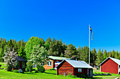 Typical farm in Lapland against a blue sky, near Salmi, Norrbottens Län, Sweden