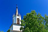 Wooden church and birch against a blue sky, Arvidsjaur, Norrbottens Län, Sweden