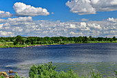 A large lake with a wooded shore and beautiful cloudscape, near Fors, Dalarna, Sweden