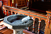 Baptismal font with toy mouse in the old church in Kopparberg, Örebro Province, Sweden