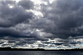 Very dark rain clouds over a lake near Meselefors, Västernorrland Province, Sweden