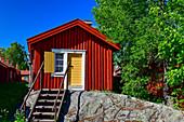 Traditional red wooden hut with stairs on a rock, Lövanger Kyrkstad, Västerbottens Län, Schwden