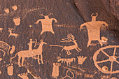 Hunter on horseback with deer or elk petroglyphs made by Ute People at Newspaper Rock in Indian Creek National Monument, formerly part of Bears Ears National Monument, southern Utah, USA