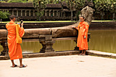Cambodia, Siem Raep; Angkor Vat, Monk and technology taking pix