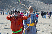 Mongolian archer aiming during archery competition at the Golden Eagle Festival grounds near the city of Ulgii (Ölgii) in the Bayan-Ulgii Province in western Mongolia.