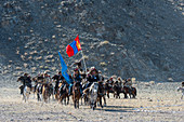 The opening ceremony of the Golden Eagle Festival with a parade of the eagle hunters on the festival grounds near the city of Ulgii (Ölgii) in the Bayan-Ulgii Province in western Mongolia.
