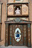 The front door of the chapel of Santo Nino de Atocha at El Santuario de Chimayo in the small community of El Potrero just outside of Chimayo, New Mexico, USA.