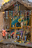 A shrine with crucifixes at the El Santuario de Chimayo in the small community of El Potrero just outside of Chimayo, New Mexico, USA.