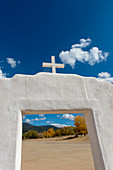 Detail of the entrance gate to the Roman Catholic Church at the Taos Pueblo which is the only living Native American community designated both a World Heritage Site by UNESCO and a National Historic Landmark in Taos, New Mexico, USA.