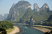 Tourist Boats on River Li with Limestone Karst\nGuilin Region\nGuangxi, China\nLA008218