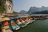 Tourist Bamboo Rafts on River Li at Xingping\nGuilin Region\nGuangxi, China\nLA008204\n