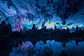 Reed Flute Caves - lit by coloured lights\nGuilin Region\nGuangxi, China\nLA008173\n