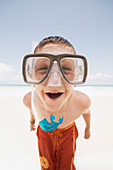 Young boy wearing goggles at the beach