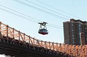 View of overhead cable car over Queensboro Bridge