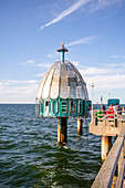 Diving bell pier in Zinnowitz with tourists, Usedom, Mecklenburg-Western Pomerania, Germany