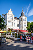 Beach promenade restaurant in Zinnowitz with vacationers and tourists, Usedom, Mecklenburg-Western Pomerania, Germany