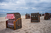 Dramatic mood Baltic beach on Usedom cloudy sky, seagulls and beach chairs Zinnowitz pier, Usedom, Mecklenburg-Western Pomerania, Germany