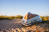 Fishing boat on the Trassenheide beach at lunchtime, Usedom, Mecklenburg-Western Pomerania, Germany