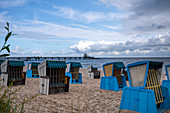 Beach chairs on Usedom in the background the Zinnowitz pier, cloudy sky, restless sea, Usedom, Mecklenburg-Western Pomerania, Germany