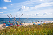 Attracktion for tourists on the beach of Zinnowitz in summer with beach chairs blue sky horizon, Usedom, Mecklenburg-Western Pomerania, Germany