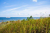 View over a dune with a white ships on the Baltic Sea blue summer sky, Usedom, Mecklenburg-Western Pomerania, Germany