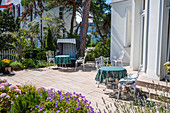 Elegant chairs in a front garden in Bansin with a beach chair, Usedom, Mecklenburg-Western Pomerania, Germany