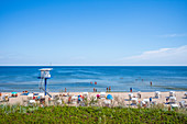 View of the beach of Heringsdorf with rescue tower and vacationers, Usedom, Mecklenburg-Western Pomerania, Germany