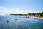 Heringsdorf beach with holidaymakers Strandköben, StandUP paddles and a water treading boat, Usedom, Mecklenburg-Western Pomerania, Germany