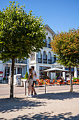 Young couple on the promenade in Kaiserbad Ahlbeck, Usedom, Mecklenburg-Western Pomerania, Germany