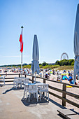 View from the pier in Ahlbeck to the beach with tourists and holidaymakers beach chairs, Usedom, Mecklenburg-Western Pomerania, Germany