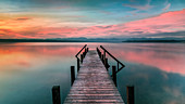 Jetty at sunrise on Lake Starnberg, Ayern, Germany