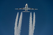 Boeing 747 with contrails