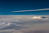 Airplanes with contrails over closed cloud cover
