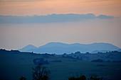Malawi; Northern Region; Nyika National Park; Dusk on the Nyika plateau; reddish sky, crossed by gray clouds